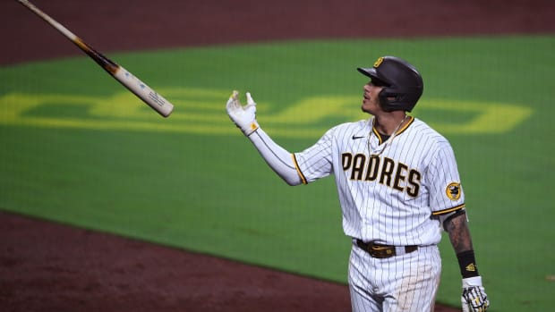 Sep 7, 2020; San Diego, California, USA; San Diego Padres third baseman Manny Machado (13) tosses his bat after grounding into a inning-ending double play during the seventh inning against the Colorado Rockies at Petco Park. Mandatory Credit: Orlando Ramirez-USA TODAY Sports