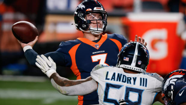 Denver Broncos quarterback Drew Lock (3) passes under pressure from Tennessee Titans linebacker Harold Landry III (58) in the fourth quarter at Empower Field at Mile High.
