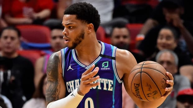 Charlotte Hornets forward Miles Bridges controls the ball during a game against the Miami Heat at American Airlines Arena.