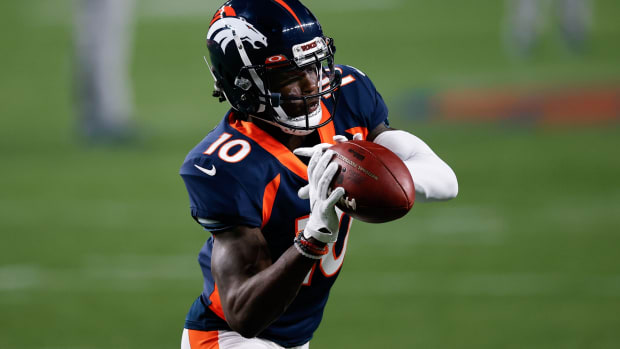 Denver Broncos wide receiver Jerry Jeudy (10) warms up before the game against the Tennessee Titans at Empower Field at Mile High.