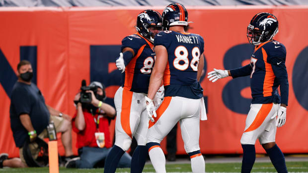 Denver Broncos tight end Noah Fant (87) celebrates his touchdown with tight end Nick Vannett (88) and wide receiver DaeSean Hamilton (17) in the first quarter against the Tennessee Titans at Empower Field at Mile High.