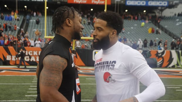 Dec 29, 2019; Cincinnati, Ohio, USA; Cincinnati Bengals running back Joe Mixon (left) talks with Cleveland Browns wide receiver Odell Beckham (right) after the Bengals defeated the Browns at Paul Brown Stadium. Mandatory Credit: David Kohl-USA TODAY Sports