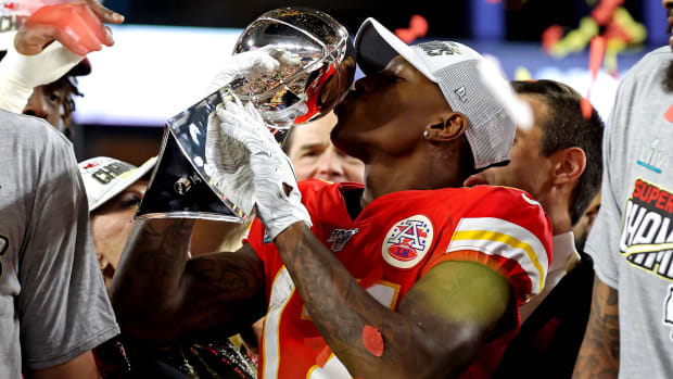 Feb 2, 2020; Miami Gardens, Florida, USA; Kansas City Chiefs wide receiver Mecole Hardman (17) kisses the Vince Lombardi Trophy after beating the San Francisco 49ers in Super Bowl LIV at Hard Rock Stadium. Mandatory Credit: Matthew Emmons-USA TODAY Sports