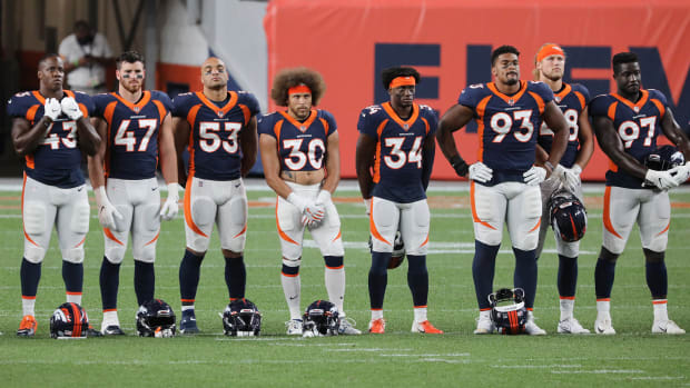 Broncos players, including Phillip Lindsay, line up before the 2020 season opener