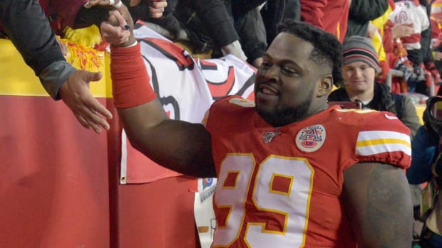 Jan 12, 2020; Kansas City, Missouri, USA; Kansas City Chiefs defensive tackle Khalen Saunders (99) greets fans while leaving the field after the AFC Divisional Round playoff football game against the Houston Texans at Arrowhead Stadium. Mandatory Credit: Denny Medley-USA TODAY Sports