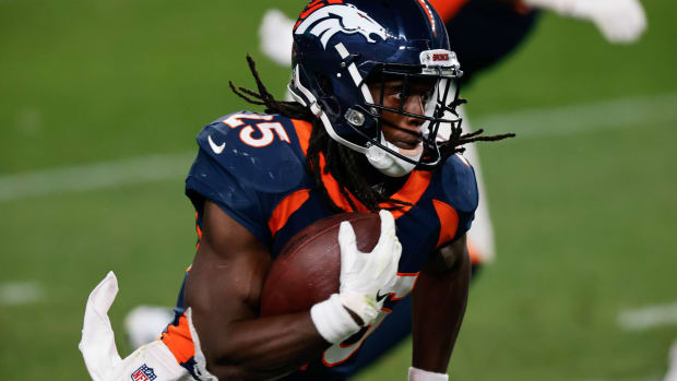 Denver Broncos running back Melvin Gordon III (25) runs the ball on a catch in the fourth quarter against the Tennessee Titans at Empower Field at Mile High.