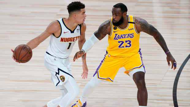 Los Angeles Lakers' LeBron James pressures Denver Nuggets' Michael Porter Jr.