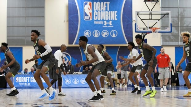 Players warm up during the 2019 NBA Draft Combine at Quest Multisport Complex in Chicago.