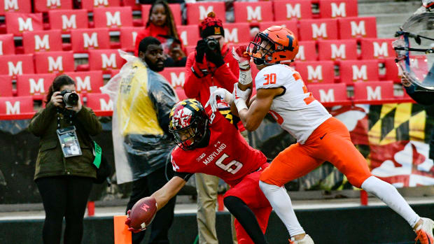 Oct 27, 2018; College Park, MD, USA; Maryland Terrapins wide receiver Jeshaun Jones (6) reaches for a touchdown as Illinois Fighting Illini defensive back Sydney Brown (30) defends during the third quarter at Capital One Field at Maryland Stadium. Mandatory Credit: Tommy Gilligan-USA TODAY Sports