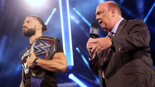WWE's Paul Heyman in the ring with Roman Reigns