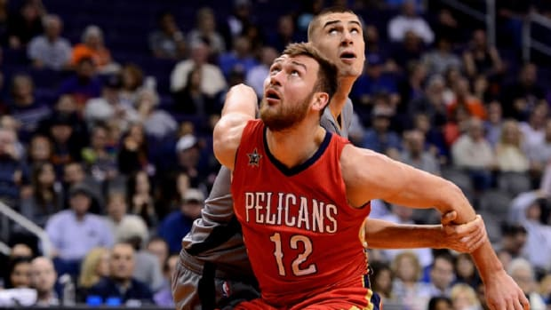 Former New Orleans Pelicans forward Donatas Motiejunas (12) boxes out Phoenix Suns center Alex Len (21) in the first half of the NBA game at Talking Stick Resort Arena.