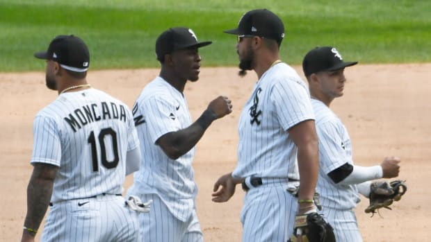 The Chicago White Sox celebrate after defeating the Minnesota Twins at Guaranteed Rate Field to clinch a playoff berth.
