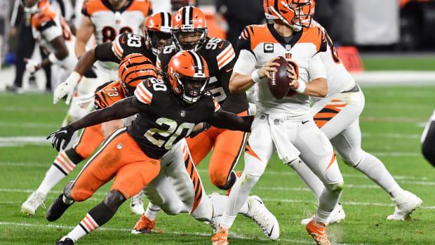 Sep 17, 2020; Cleveland, Ohio, USA; Cleveland Browns cornerback Tavierre Thomas (20) rushes Cincinnati Bengals quarterback Joe Burrow (9) during the second half at FirstEnergy Stadium. Mandatory Credit: Ken Blaze-USA TODAY Sports