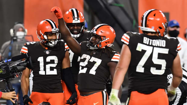 Sep 17, 2020; Cleveland, Ohio, USA; Cleveland Browns running back Kareem Hunt (27) celebrates after scoring a touchdown during the second half against the Cincinnati Bengals at FirstEnergy Stadium. Mandatory Credit: Ken Blaze-USA TODAY Sports