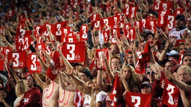 Fans hold up the No. 3 in honor of Tyler Hilinski