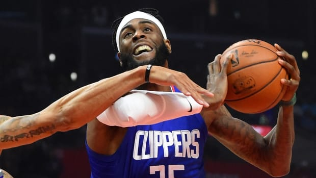 Former Los Angeles Clippers center Willie Reed is fouled during a game against the Sacramento Kings at Staples Center.