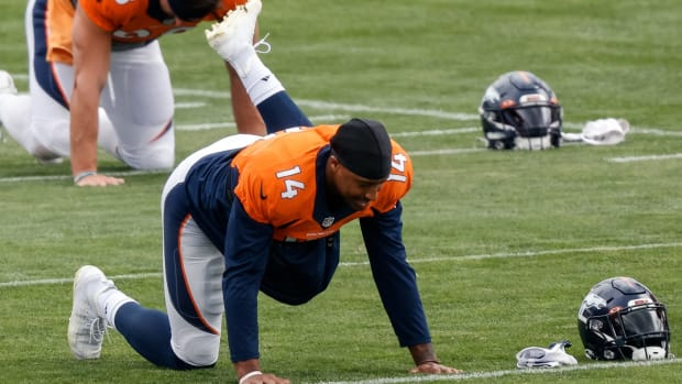 Denver Broncos wide receiver Courtland Sutton (14) stretches during practice at UCHealth Training Center.