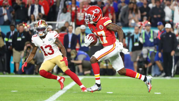 Feb 2, 2020; Miami Gardens, Florida, USA; Kansas City Chiefs wide receiver Mecole Hardman (17) runs past San Francisco 49ers wide receiver Richie James (13) in the first quarter in Super Bowl LIV at Hard Rock Stadium. Mandatory Credit: Mark J. Rebilas-USA TODAY Sports