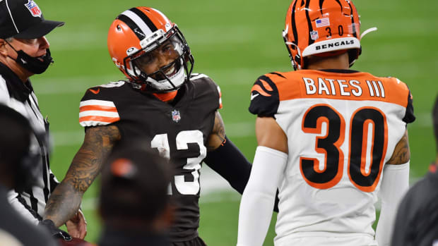 Sep 17, 2020; Cleveland, Ohio, USA; Cleveland Browns wide receiver Odell Beckham Jr. (13) smiles at Cincinnati Bengals free safety Jessie Bates (30) after a catch during the first half at FirstEnergy Stadium. Mandatory Credit: Ken Blaze-USA TODAY Sports