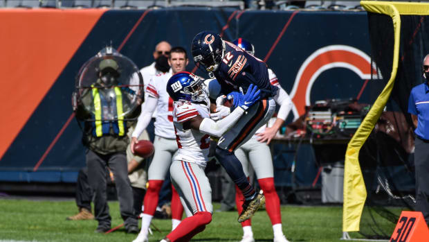 Sep 20, 2020; Chicago, Illinois, USA; New York Giants cornerback James Bradberry (24) and Chicago Bears wide receiver Allen Robinson (12) jump for the ball during the fourth quarter at Soldier Field. Bradberry would be rewarded with an interception after replay review.