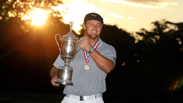 Bryson DeChambeau poses and celebrates with the trophy after winning the U.S. Open golf tournament at Winged Foot Golf Club - West.