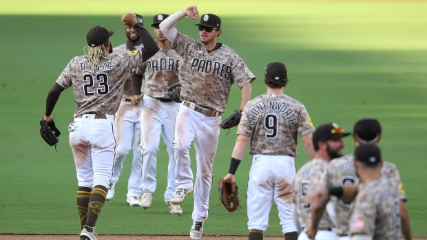 The San Diego Padres celebrate after clinching a playoff spot for the first time since 2006.