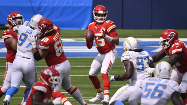 Sep 20, 2020; Inglewood, California, USA; Kansas City Chiefs quarterback Patrick Mahomes (15) drops back to pass against the Los Angeles Chargers during the first quarter at SoFi Stadium. Mandatory Credit: Robert Hanashiro-USA TODAY Sports
