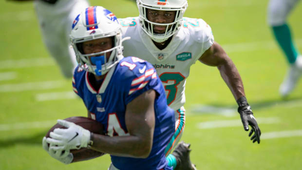 Miami Dolphins cornerback Noah Igbinoghene (23) is beat for a touchdown by Buffalo Bills wide receiver Stefon Diggs (14) at Hard Rock Stadium in Miami Gardens, September 20, 2020. [ALLEN EYESTONE/The Palm Beach Post]