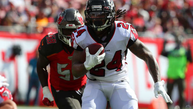 Dec 29, 2019; Tampa, Florida, USA; Atlanta Falcons running back Devonta Freeman (24) runs with the ball against the Tampa Bay Buccaneers during the first quarter at Raymond James Stadium.