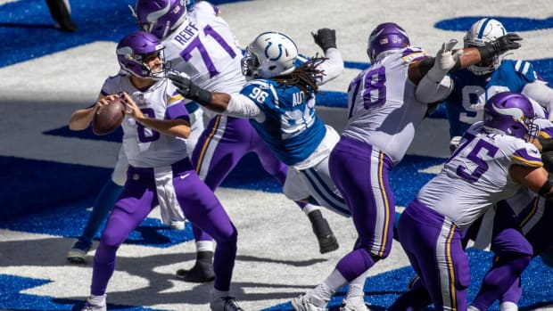 Indianapolis Colts defensive tackle Denico Autry (96) pressures Minnesota Vikings quarterback Kirk Cousins (8) before DeForest Buckner (99) cleans up for a sack and safety on Sunday.