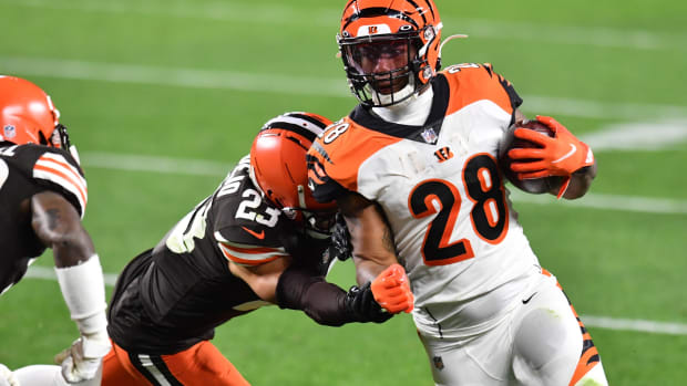 Sep 17, 2020; Cleveland, Ohio, USA; Cleveland Browns strong safety Andrew Sendejo (23) tackles Cincinnati Bengals running back Joe Mixon (28) during the second half at FirstEnergy Stadium. Mandatory Credit: Ken Blaze-USA TODAY Sports