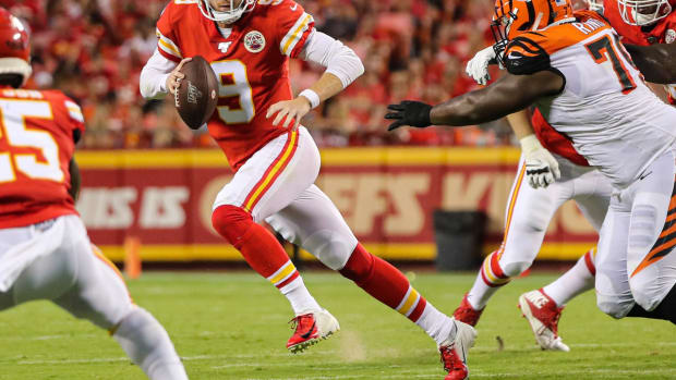 Kansas City Chiefs quarterback Kyle Shurmur (9) runs against Cincinnati Bengals defensive end Christian Ringo (79) during the first half at Arrowhead Stadium.