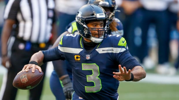 Russell Wilson of the Seattle Seahawks throws a pass