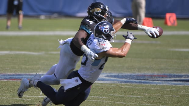 Jacksonville Jaguars middle linebacker Myles Jack (44) deflects the pass from Tennessee Titans tight end Anthony Firkser (86) during the second half at Nissan Stadium.