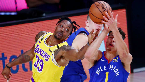 Los Angeles Lakers center Dwight Howard and Denver Nuggets forward Michael Porter Jr. reach for the ball during the Western Conference Finals