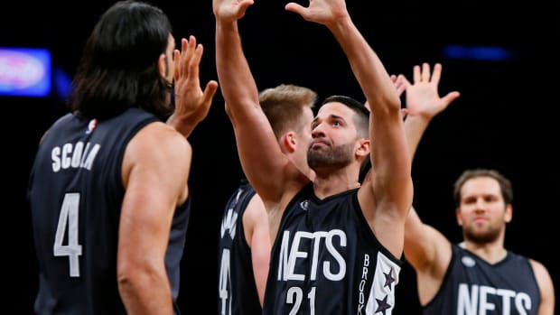 Oct 28, 2016; Brooklyn, NY, USA; Brooklyn Nets guard Greivis Vasquez (21) and forward Luis Scola (4) react after leading in the fourth quarter against the Indiana Pacers during second half at Barclays Center. The Nets won 103-94.Mandatory Credit: Noah K. Murray-USA TODAY Sports