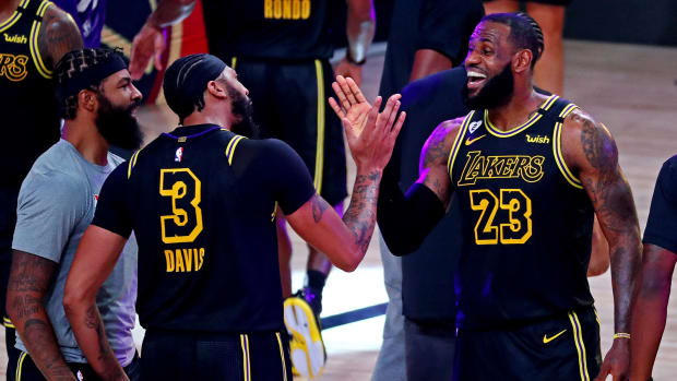 Los Angeles Lakers forward Anthony Davis with forward LeBron James after making the game winning basket to beat the Denver Nuggets