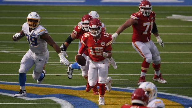 Sep 20, 2020; Inglewood, California, USA; Kansas City Chiefs quarterback Patrick Mahomes (15) runs the ball against the Los Angeles Chargers during the fourth quarter at SoFi Stadium. Mandatory Credit: Robert Hanashiro-USA TODAY Sports