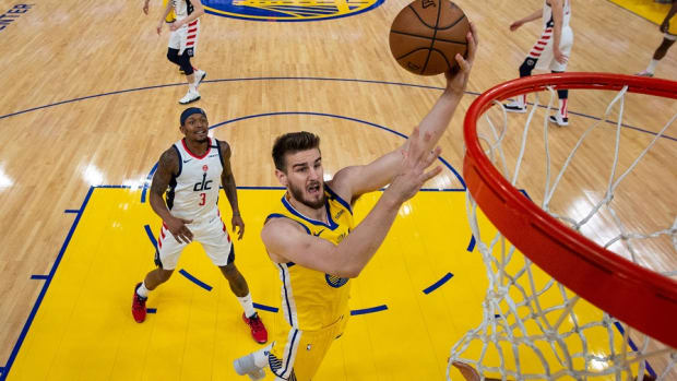 Former Golden State Warriors forward Dragan Bender goes up for a layup against the Washington Wizards at Chase Center.