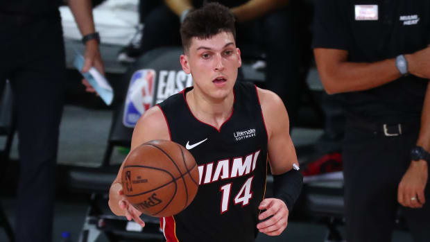 Miami Heat guard Tyler Herro (14) brings the ball up court against the Boston Celtics during the first half of game four of the Eastern Conference Finals of the 2020 NBA Playoffs