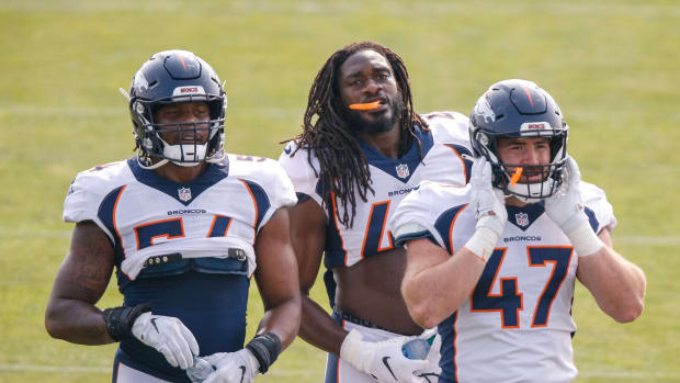 Denver Broncos linebacker Josh Watson (54) and linebacker Alexander Johnson (45) and linebacker Josey Jewell (47) during training camp at the UCHealth Training Center.