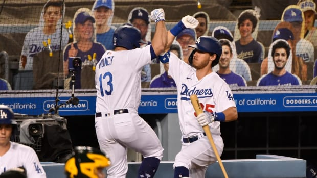 Sep 23, 2020; Los Angeles, California, USA; Los Angeles Dodgers second baseman Max Muncy (13) celebrates hitting a two run homer with teammate Coy Bellinger (35) in the third inning against the Oakland Athletics at Dodger Stadium. Mandatory Credit: Robert Hanashiro-USA TODAY Sports