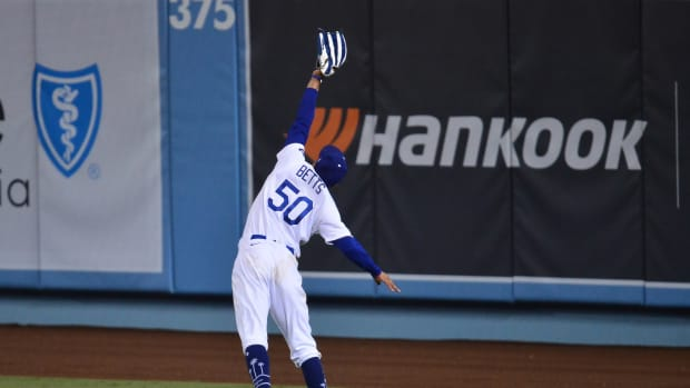 Sep 22, 2020; Los Angeles, California, USA; Los Angeles Dodgers right fielder Mookie Betts (50) catches a hit off Oakland Athletics right fielder Stephen Piscotty (25) during the ninth inning at Dodger Stadium. Mandatory Credit: Gary A. Vasquez-USA TODAY Sports