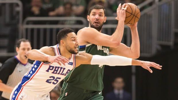 Former Milwaukee Bucks forward Nikola Mirotic looks to pass against the defense of Philadelphia 76ers guard Ben Simmons.