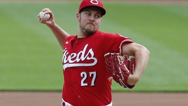 Sep 14, 2020; Cincinnati, Ohio, USA; Cincinnati Reds starting pitcher Trevor Bauer (27) throws against the Pittsburgh Pirates in the first inning during Game One of a doubleheader at Great American Ball Park. Mandatory Credit: David Kohl-USA TODAY Sports