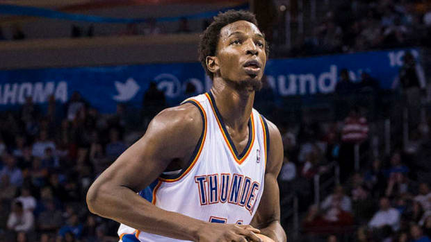Former Oklahoma City Thunder center Hasheem Thabeet shoots a free throw during a game in 2014.