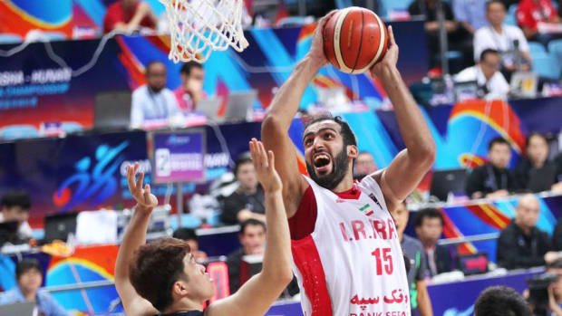 Former Memphis Grizzlies center Hamed Haddadi goes up for a shot while playing for the Iranian national team.