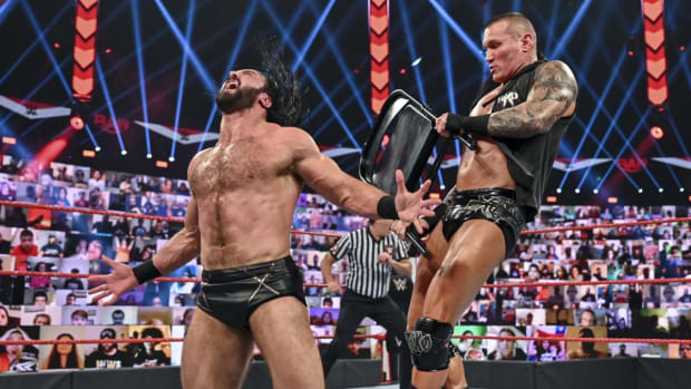 WWE's Randy Orton hits Drew McIntyre with a chair