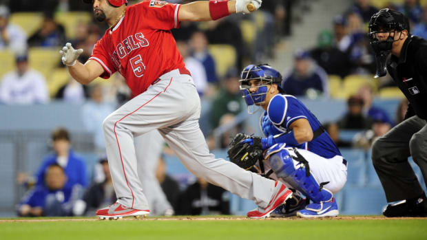 March 26, 2018; Los Angeles, CA, USA; Los Angeles Angels first baseman Albert Pujols (5) hits a single during the first inning against the Los Angeles Dodgers at Dodger Stadium. Mandatory Credit: Gary A. Vasquez-USA TODAY Sports