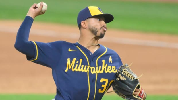 Milwaukee Brewers relief pitcher Devin Williams (38) delivers in the seventh inning against the Cleveland Indians at Progressive Field.